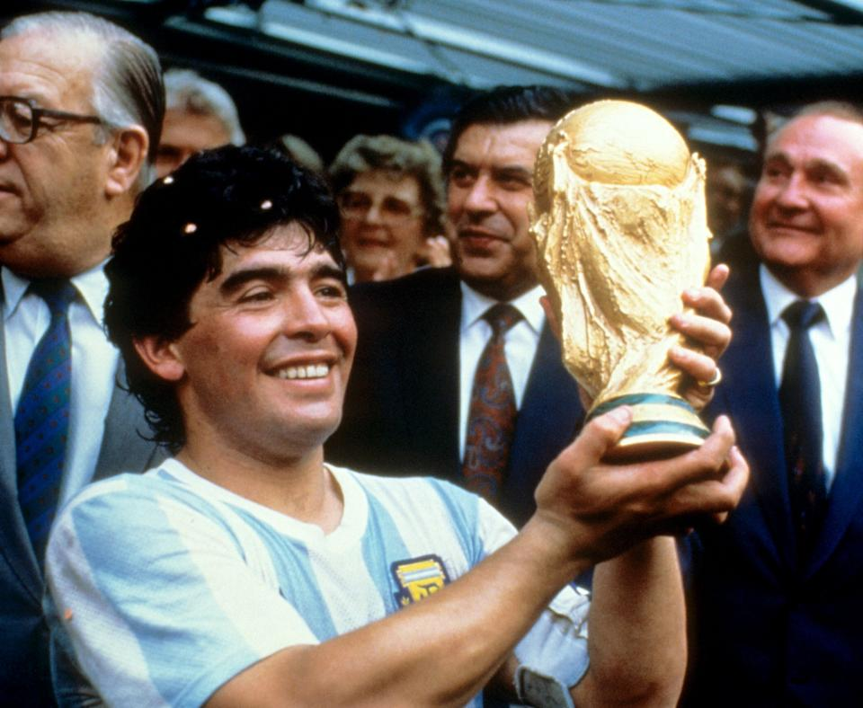 <strong>Diego Maradona holds up the World Cup trophy in 1986.</strong> (Photo: EMPICS Sport)