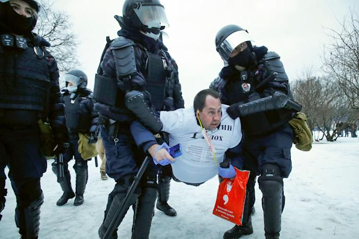 Police detain a man during a St. Petersburg protest against the jailing of opposition leader Alexei Navalny in this Jan. 23, 2021 photo.