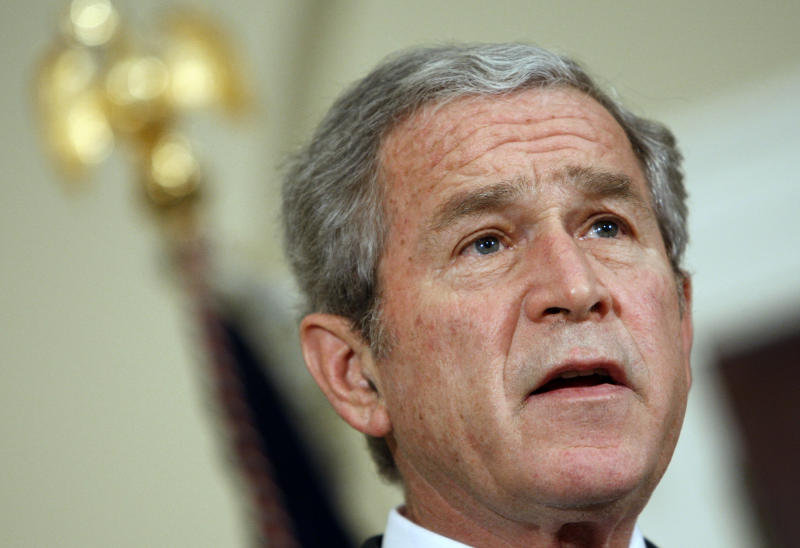 FILE - This Dec. 19, 2008 file photo shows President George W. Bush speaking about the auto industry, in the Roosevelt Room at the White House in Washington. Second presidential terms are never easy. More often, they're fraught with peril, frequently marred by scandal, failure, hubris, and burnout and souring relations with Congress. (AP Photo/Ron Edmonds, File)