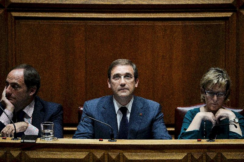 Portuguese Prime Minister Pedro Passos Coelho (centre) won the most votes in last month's elections but his centre-right coalition has lost the absolute majority it had enjoyed since 2011 (AFP Photo/Patricia De Melo Moreira)