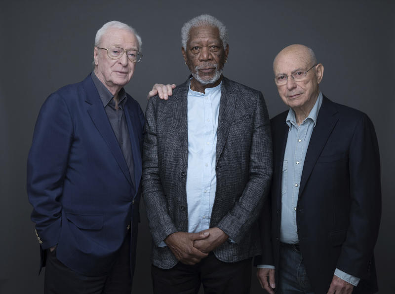 """In this March 27, 2017 photo, actors Michael Caine, Morgan Freeman and Alan Arkin pose for a portrait to promote their new film """"Going in Style"""" in New York. (Photo by Amy Sussman/Invision/AP)"""