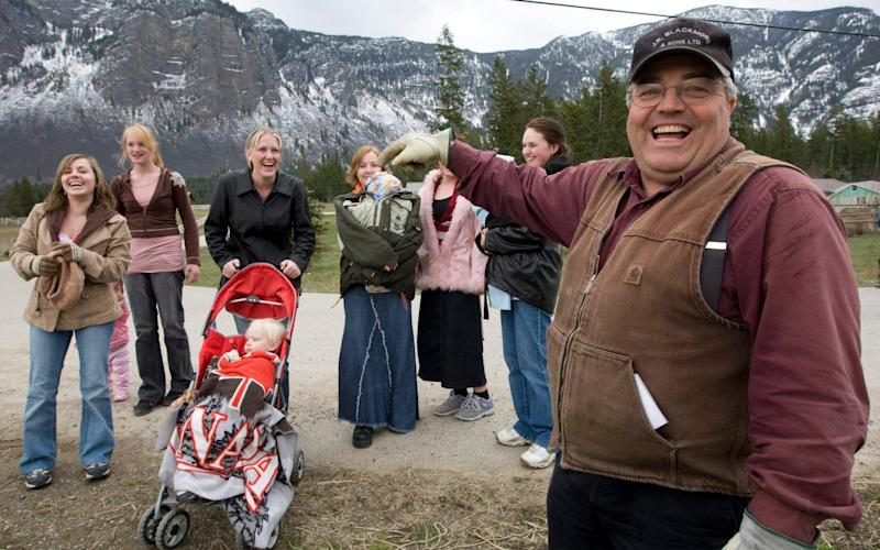 Winston Blackmore, the religious leader of the controversial polygamous community of Bountiful located near Creston, British Columbia, Canada, shares a laugh with six of his daughters and some of his grandchildren - The Canadian Press