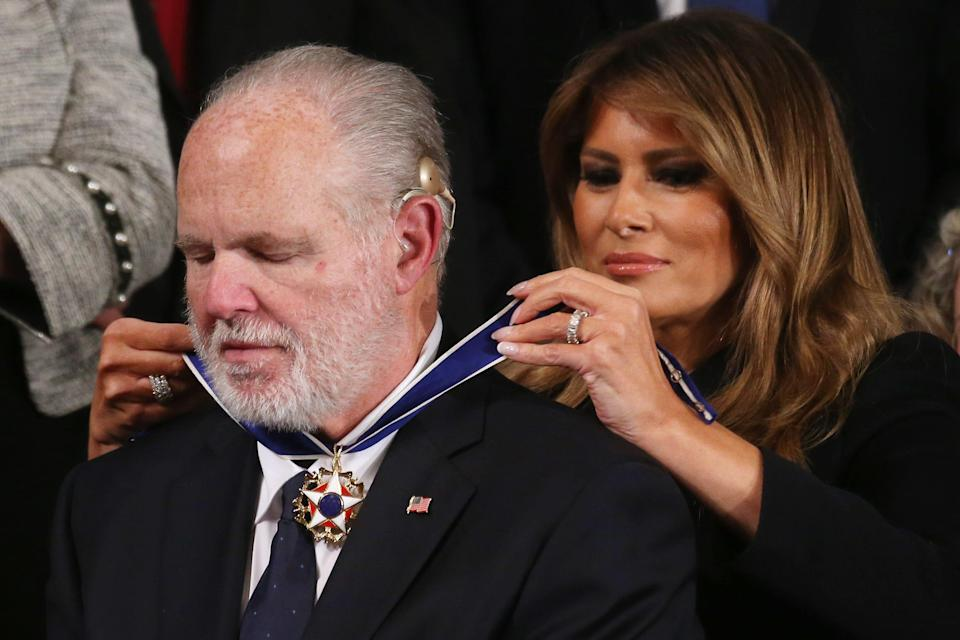 First lady Melania Trump fastens the Presidential Medal of Freedom awarded to Rush Limbaugh during the State of the Union address in the House of Representatives on Feb. 4, 2020.