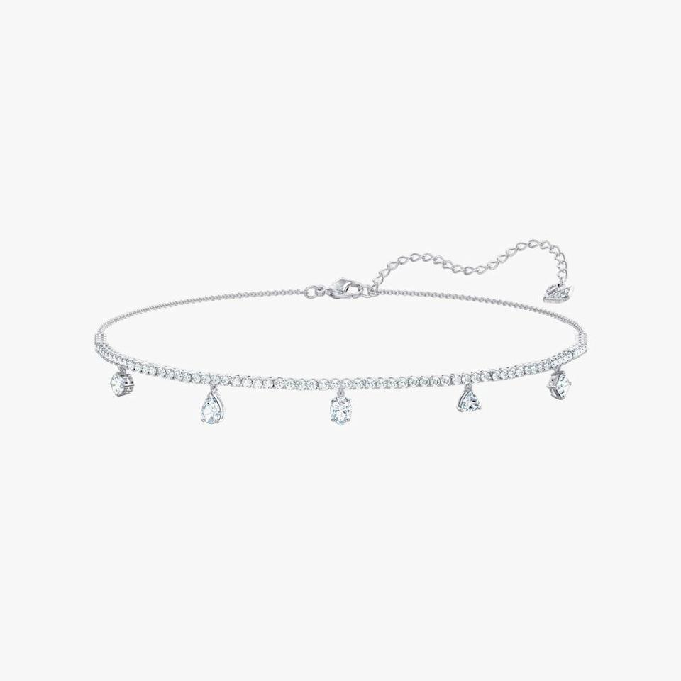 "$189, SWAROVSKI. <a href=""https://www.swarovski.com/en-US/p-5562084/Tennis-Deluxe-Mixed-Choker-White-Rhodium-plated/"" rel=""nofollow noopener"" target=""_blank"" data-ylk=""slk:Get it now!"" class=""link rapid-noclick-resp"">Get it now!</a>"