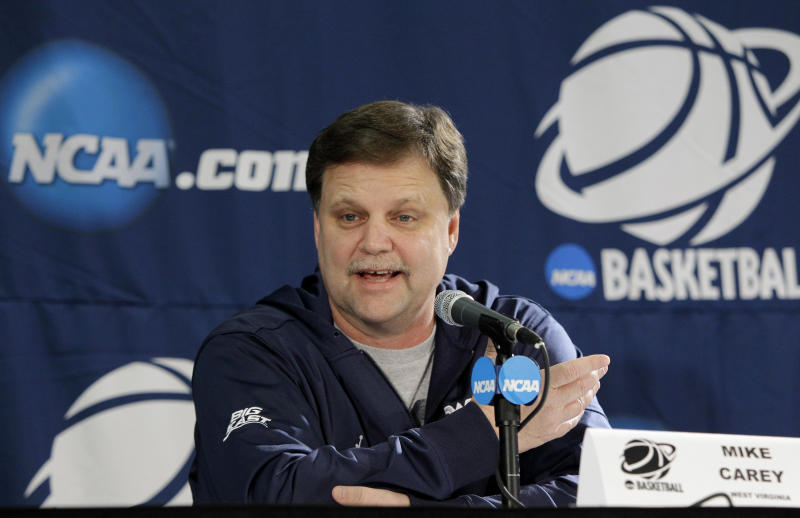 West Virginia head coach Mike Carey responds to a question during a news conference in the second round of the NCAA women's college basketball tournament, Monday, March 21, 2011, in Waco, Texas. West Virginia will play Baylor on Tuesday. (AP Photo/Tony Gutierrez)
