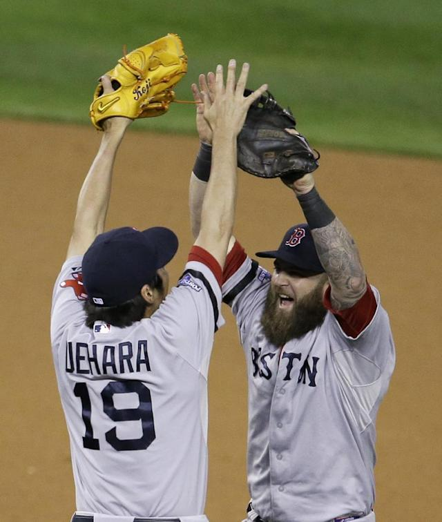 Boston Red Sox's Koji Uehara celebrates with Mike Napoli after the Red Sox defeating the Detroit Tigers 4-3 in Game 5 of the American League baseball championship series Thursday, Oct. 17, 2013, in Detroit. (AP Photo/Carlos Osorio)