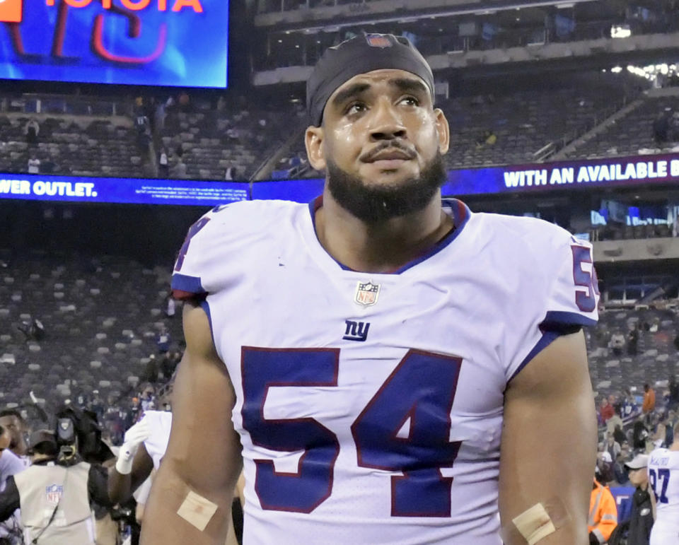 FILE - In this Oct. 11, 2018, file photo, New York Giants linebacker Olivier Vernon leaves the field after an NFL football game against the Philadelphia Eagles in East Rutherford, N.J. Vernon is having a disappointing season with only one sack in six games. (AP Photo/Bill Kostroun, File)