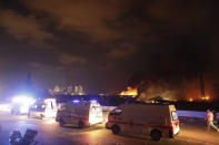 Ambulances drive past the site of a massive explosion in Beirut, Lebanon, Tuesday, Aug. 4, 2020. (AP Photo/Hassan Ammar)