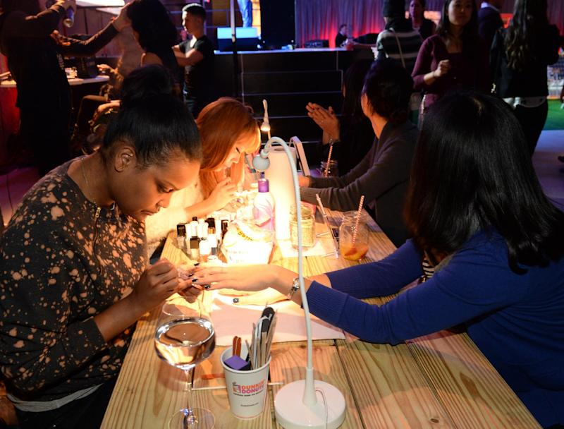 Customers having their nails done at a bar in New York before lockdown (Getty )