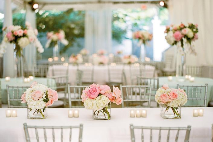 """<p>Tables were accented with arrangements of peonies, garden roses, and hydrangeas.</p> <p><strong>Love It? Get It!</strong><br><strong>Ceremony Venue:</strong> West End United Methodist Church, <a href=""""http://www.westendumc.org/"""" rel=""""nofollow noopener"""" target=""""_blank"""" data-ylk=""""slk:westendumc.org"""" class=""""link rapid-noclick-resp"""">westendumc.org</a> or 615/321-8500<br><strong>Reception Venue & Catering:</strong> Belle Meade Country Club, <a href=""""http://bellemeadecc.org/"""" rel=""""nofollow noopener"""" target=""""_blank"""" data-ylk=""""slk:bellemeadecc.org"""" class=""""link rapid-noclick-resp"""">bellemeadecc.org</a> or 615/385-0150<br><strong>Flowers:</strong> The Tulip Tree, <a href=""""http://thetuliptreeinc.com/"""" rel=""""nofollow noopener"""" target=""""_blank"""" data-ylk=""""slk:thetuliptreeinc.com"""" class=""""link rapid-noclick-resp"""">thetuliptreeinc.com</a> or 615/352-1466<br><strong>Band:</strong> Right On Band, <a href=""""http://eastcoastentertainment.com/"""" rel=""""nofollow noopener"""" target=""""_blank"""" data-ylk=""""slk:eastcoastentertainment.com"""" class=""""link rapid-noclick-resp"""">eastcoastentertainment.com</a> <br><strong>Photo/Video Booth:</strong> Ace Photobooths, <a href=""""http://acephotobooths.com/"""" rel=""""nofollow noopener"""" target=""""_blank"""" data-ylk=""""slk:acephotobooths.com"""" class=""""link rapid-noclick-resp"""">acephotobooths.com</a> or 615/415-7909<br><strong>Draping:</strong> Visual Elements, <a href=""""http://veevents.com/"""" rel=""""nofollow noopener"""" target=""""_blank"""" data-ylk=""""slk:veevents.com"""" class=""""link rapid-noclick-resp"""">veevents.com</a> or 615/884-5455<br><strong>Lighting:</strong> Bradfield Stage Lighting, <a href=""""http://bradfieldcompany.com/home/Home.html"""" rel=""""nofollow noopener"""" target=""""_blank"""" data-ylk=""""slk:bradfieldcompany.com"""" class=""""link rapid-noclick-resp"""">bradfieldcompany.com</a> or 615/256-0977<br><strong>Sound:</strong> Brantley Sound Associates, <a href=""""http://brantleysound.com/"""" rel=""""nofollow noopener"""" target=""""_blank"""" data-ylk=""""slk:brantleysound.com"""" class=""""link rapid-noclick-resp"""">brantleysound.com<"""