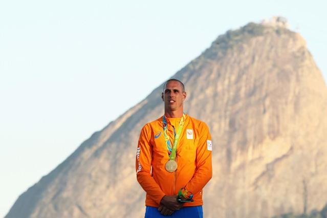 <p>Dorian van Rijsselberghe of the Netherlands celebrates winning the gold medal in the Men's RS:X class on Day 9 of the Rio 2016 Olympic Games at the Marina da Gloria on August 14, 2016 in Rio de Janeiro, Brazil. (Photo by Mark Kolbe/Getty Images) </p>