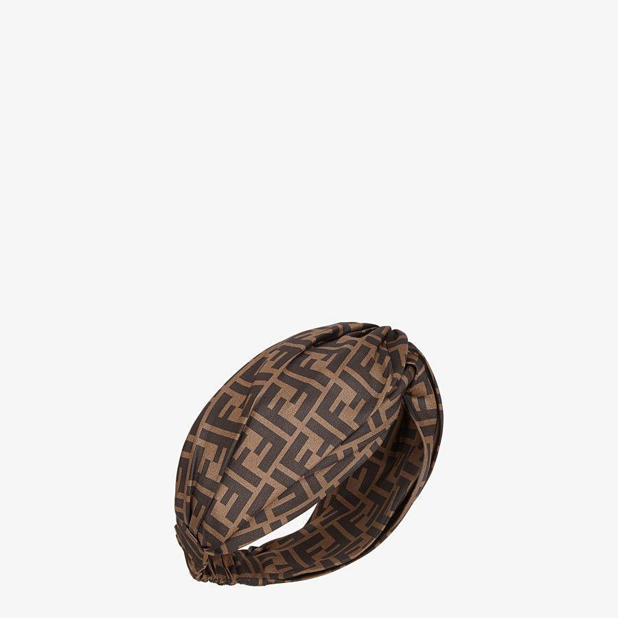 """<h2>Fendi Brown Silk Headband/Turban</h2><br>""""I used to get my hair relaxed, colored, deep conditioned, and cut every two months, but after COVID that all changed. Thing is, I still needed to be put-together on Zoom calls, but I have zero time, especially with a family, to even think about my hair. Showering is an accomplishment these days. I feel ready for the day, chic but relaxed when I wear it and it saves me a ton a time. I put on some lip balm and mascara and log on for the day. Also, it's a silk blend so it's soft, cozy, but breathable. I can wear it anywhere, including in bed when I accidentally fall asleep with my laptop."""" – <a href=""""https://www.instagram.com/simonesoliver/?hl=en"""" rel=""""nofollow noopener"""" target=""""_blank"""" data-ylk=""""slk:Simone Oliver"""" class=""""link rapid-noclick-resp""""><em>Simone Oliver</em></a><em>, Global Editor In Chief</em><br><br><em>Shop <strong><a href=""""https://www.fendi.com/us/textile-accessories-woman"""" rel=""""nofollow noopener"""" target=""""_blank"""" data-ylk=""""slk:Fendi"""" class=""""link rapid-noclick-resp"""">Fendi</a></strong></em> <br><br><strong>Fendi</strong> Fendi Brown Silk Headband/Turban, $, available at <a href=""""https://go.skimresources.com/?id=30283X879131&url=https%3A%2F%2Fwww.fendi.com%2Fus%2Ftextile-accessories-woman%2Fff-band-fxt266a3opf0qe1"""" rel=""""nofollow noopener"""" target=""""_blank"""" data-ylk=""""slk:Fendi"""" class=""""link rapid-noclick-resp"""">Fendi</a>"""