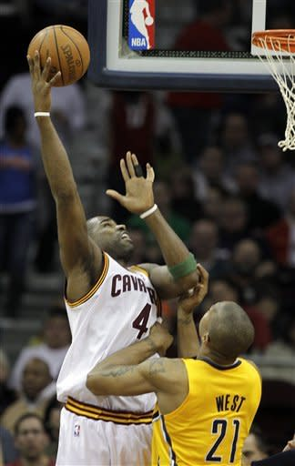 Cleveland Cavaliers' Antawn Jamison (4) hooks in a shot over Indiana Pacers' David West (21) in the second quarter of an NBA basketball game Wednesday, April 11, 2012, in Cleveland. (AP Photo/Mark Duncan)