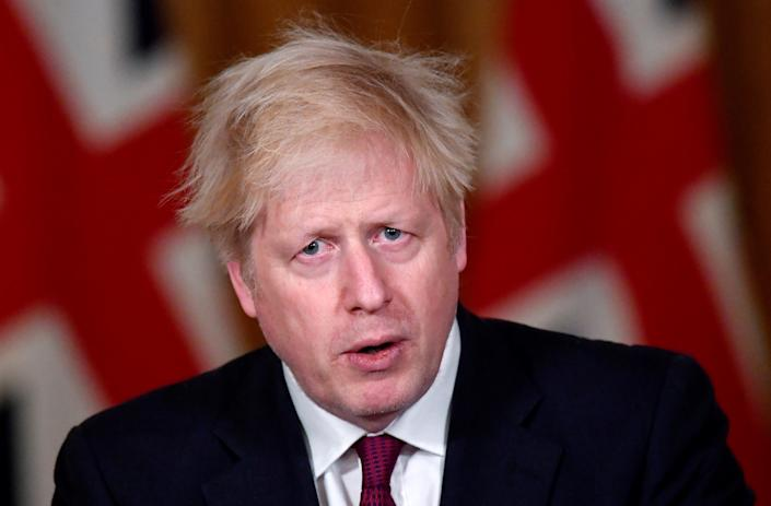 """Britain's Prime Minister Boris Johnson attends a virtual press conference inside 10 Downing Street in central London on December 19, 2020. - British Prime Minister Boris Johnson on Saturday announced a """"stay at home"""" order for London and southeast England to slow a new coronavirus strain that is significantly more infectious. The new strain of the virus """"does appear to be passed on significantly more easily,"""" Johnson said at a televised briefing. He ordered new restrictions for London and south-eastern England from Sunday, saying that under the new """"tier four"""" rules, """"residents in those areas must stay at home"""" at least until December 30. (Photo by TOBY MELVILLE / POOL / AFP) (Photo by TOBY MELVILLE/POOL/AFP via Getty Images)"""