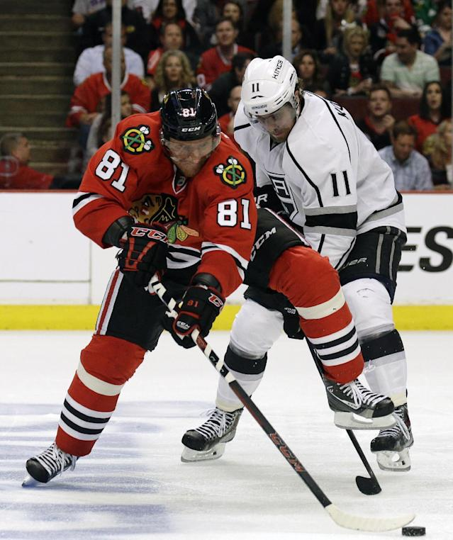 Chicago Blackhawks right wing Marian Hossa (81) and Los Angeles Kings center Anze Kopitar (11) battle for the puck during the second period in Game 5 of the Western Conference finals in the NHL hockey Stanley Cup playoffs Wednesday, May 28, 2014, in Chicago. (AP Photo/Nam Y. Huh)