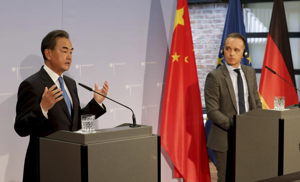 German Foreign Minister Heiko Maas, right, and China's Foreign Minister Wang Yi, left, address the media during a joint press conference as part of a meeting in Berlin, Germany, Tuesday, Sept. 1, 2020. (AP Photo/Michael Sohn, pool)