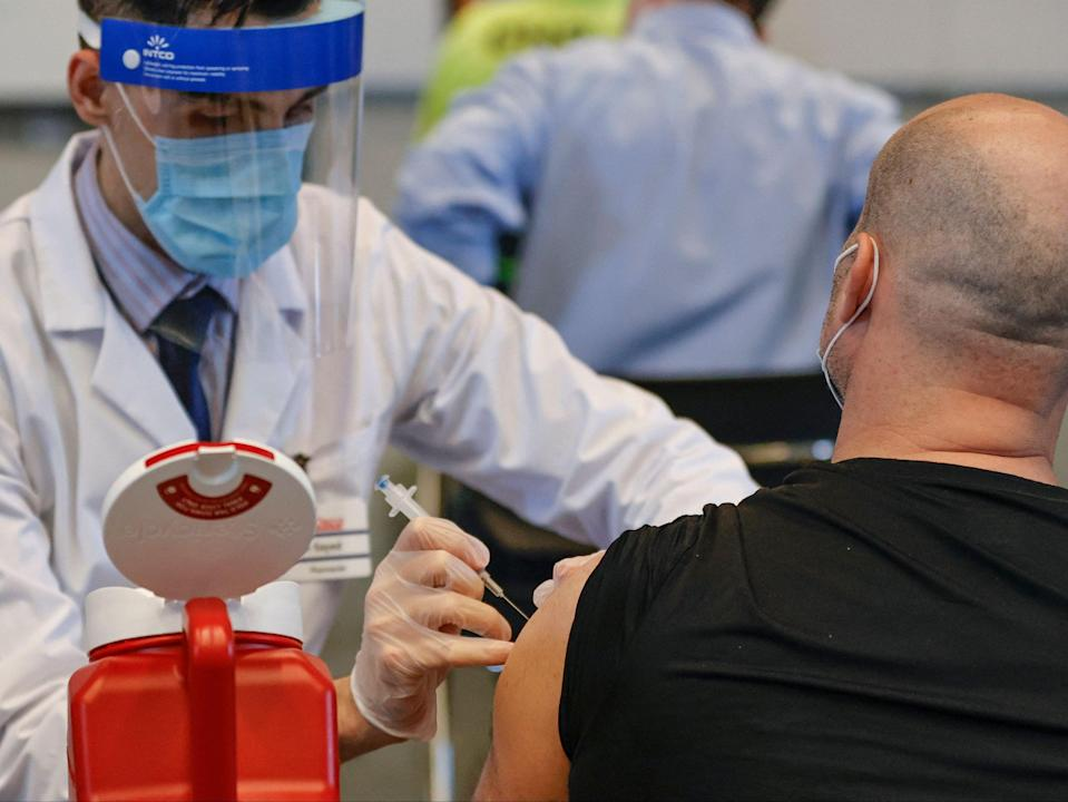 A man receives the Johnson & Johnson vaccine at a vaccination site in Chicago (AFP via Getty Images)