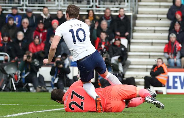 Harry Kane was injured in this clash with Bournemouth keeper Asmir Begovic. (Getty)