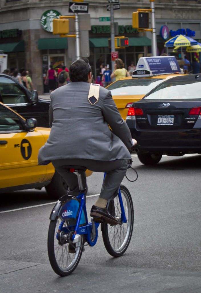 In this Tuesday, June 25, 2013, photo, a biker rides without a helmet on a Citibike, as part of New York City's bike sharing system, in New York. Under Mayor Bloomberg, the city has cracked down on smoking, fatty foods and sugary drinks for health concerns, but the nations largest bike-share program allow riders without helmets. (AP Photo/Bebeto Matthews)