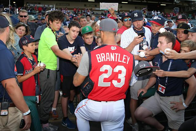 Michael Brantley #23 of the Houston Astros signs autographs prior to the 90th MLB All-Star Game at Progressive Field on Tuesday, July 9, 2019 in Cleveland, Ohio. (Photo by Rob Tringali/MLB Photos via Getty Images)