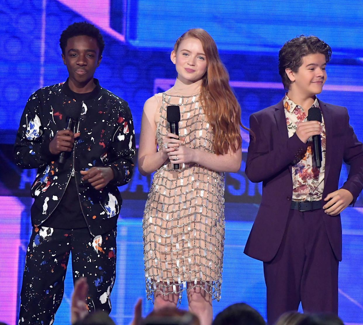 LOS ANGELES, CA - NOVEMBER 19: (L-R) Caleb McLaughlin, Sadie Sink, and Gaten Matarazzo speak onstage during the 2017 American Music Awards at Microsoft Theater on November 19, 2017 in Los Angeles, California. (Photo by Lester Cohen/WireImage)