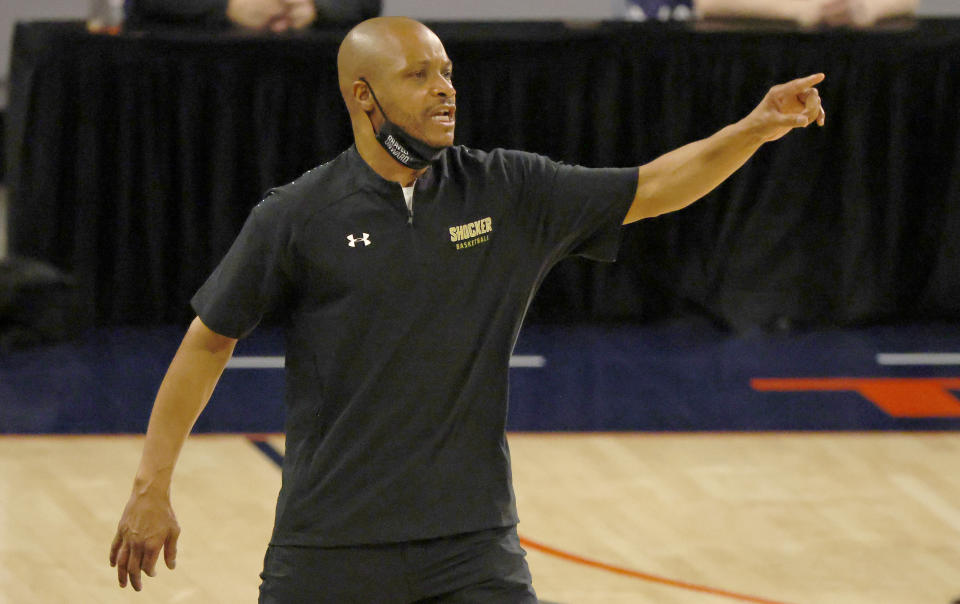Wichita State head coach Isaac Brown calls a play as his team plays Cincinnati during the second half of an NCAA college basketball game in the semifinal round of the American Athletic Conference men's tournament Saturday, March 13, 2021, in Fort Worth, Texas. (AP Photo/Ron Jenkins)