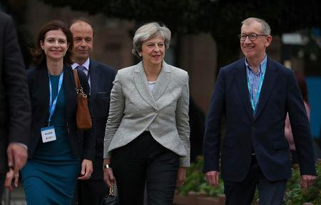 Britain's Prime Minister, Theresa May and her husband Philip, arrive at the conference centre on the  opening day of the Conservative Party Conference, in Manchester, Britain October 1, 2017. REUTERS/Hannah McKay