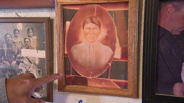 PHOTO: Principal Chief David Hill of the Muscogee Creek Nation points to a picture of his great grandmother, who he said lived during the U.S. government's forced relocation of Native Americans in the 1800s, known as the 'Trail of Tears.' (ABC News)