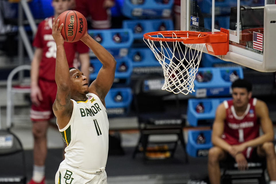 Baylor guard Mark Vital (11) gets a dunk against Wisconsin in the first half of a second-round game in the NCAA men's college basketball tournament at Hinkle Fieldhouse in Indianapolis, Sunday, March 21, 2021. (AP Photo/Michael Conroy)