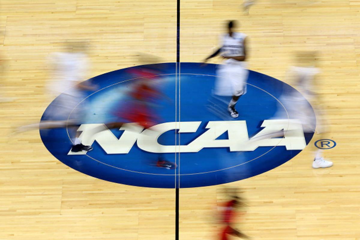 JACKSONVILLE, FL - MARCH 19: Mississippi Rebels and Xavier Musketeers players run by the logo at mid-court during the second round of the 2015 NCAA Men's Basketball Tournament at Jacksonville Veterans Memorial Arena on March 19, 2015 in Jacksonville, Florida. (Photo by Mike Ehrmann/Getty Images) Photographer: Mike Ehrmann/Getty Images North America