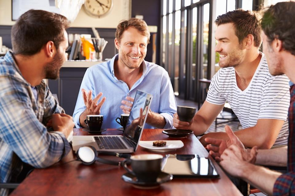 man talking to his three guy friends