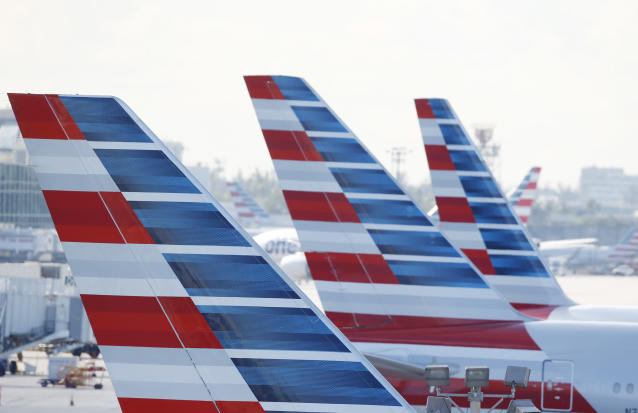 American Airlines passengers are set to have pilots in December for the holidays. (AP Photo/Wilfredo Lee)