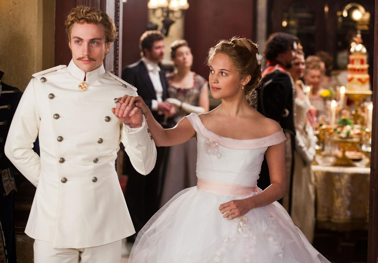 (l to r) Aaron Taylor-Johnson stars as Vronsky and Alicia Vikander stars as Kitty in director Joe Wright?s bold, theatrical new vision of the epic story of love, Anna Karenina, a Focus Features release. Credit: Laurie Sparham
