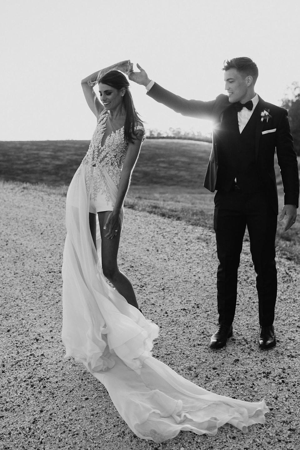 """Her reception outfit has a """"unique shorts feature"""". Photo: Chloe May"""