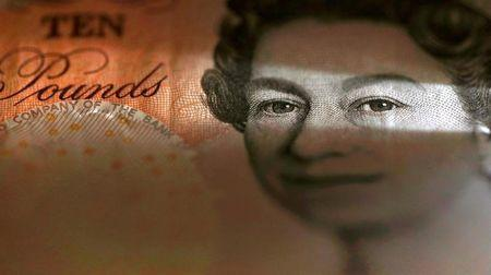 A British ten pound banknote is seen in a photo illustration