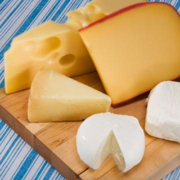 "<div class=""caption-credit""> Photo by: ThinkStock</div><div class=""caption-title"">Say Cheese</div>From savory bleu to sharp cheddar to creamy brie and camembert, cheese is a satisfying nosh on it's own or a palate-pleasing addition to any dish. Portion control is key, however, because calorie and fat counts are typically quite high. Fortunately, a mere 1.5 ounces of cheddar gives you more than 30% of your daily calcium needs, and other cheeses have similar values. Most cheeses also have small amounts of vitamin D."