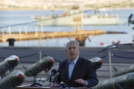 Israel's Prime Minister Netanyahu speaks to the media in front of a display of M302 rockets at a navy base in Eilat