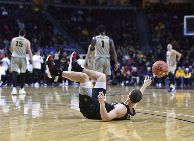 San Diego State guard Malachi Flynn (22) tosses the ball after bring fouled by an Iowa player during the second half of an NCAA college basketball game Friday, Nov. 29, 2019, in Las Vegas. (AP Photo/David Becker)