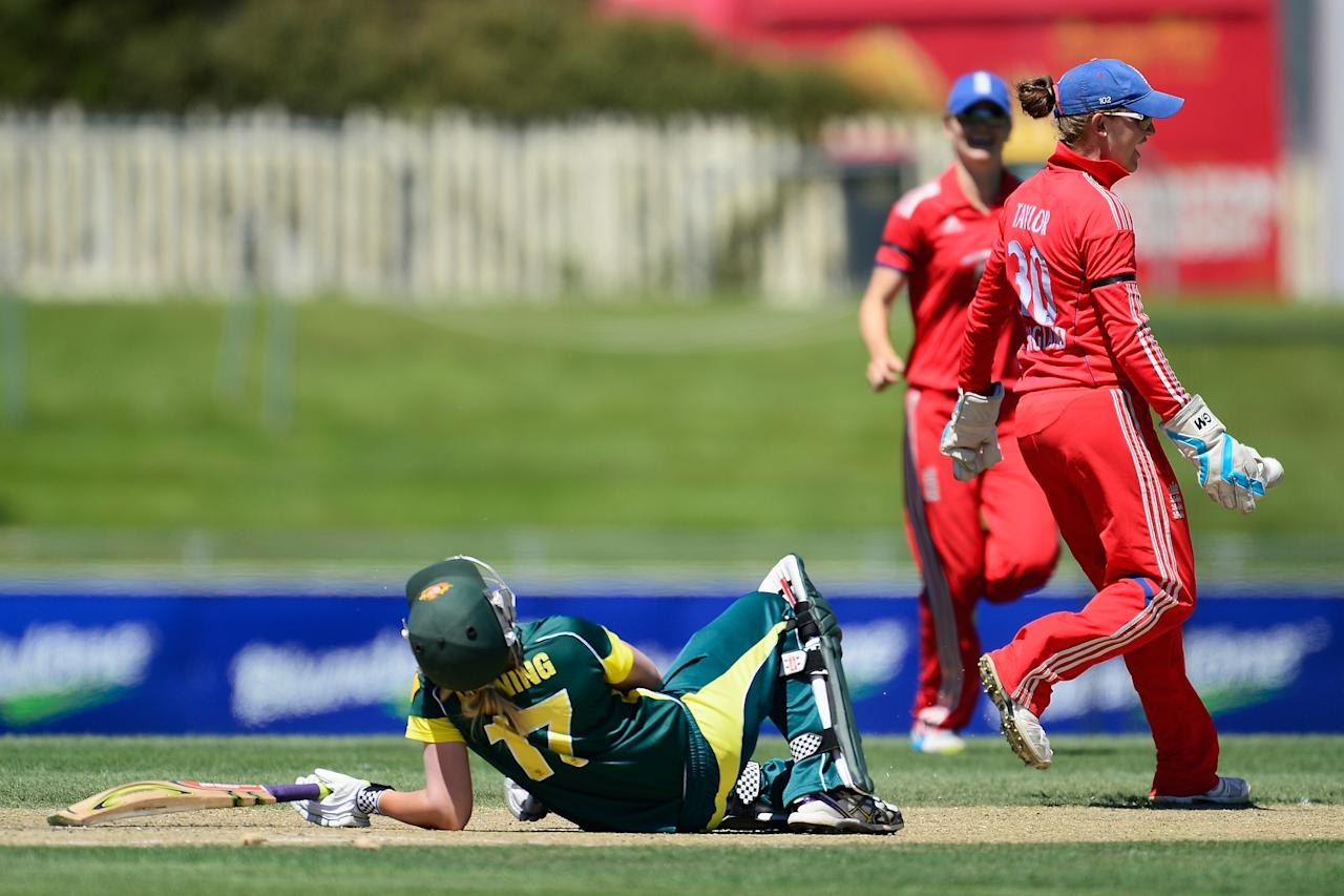 HOBART, AUSTRALIA - JANUARY 26: Sarah Taylor of England celebrates the stumping wicket of Meg Lanning of Australia during game three of the women's one day international series at Blundstone Arena on January 26, 2014 in Hobart, Australia.  (Photo by Brett Hemmings/Getty Images)