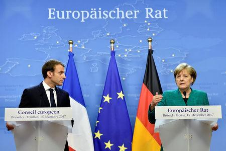 FILE PHOTO - French President Emmanuel Macron and German Chancellor Angela Merkel give a joint news conference after the EU summit in Brussels, Belgium, December 15, 2017. REUTERS/Eric Vidal