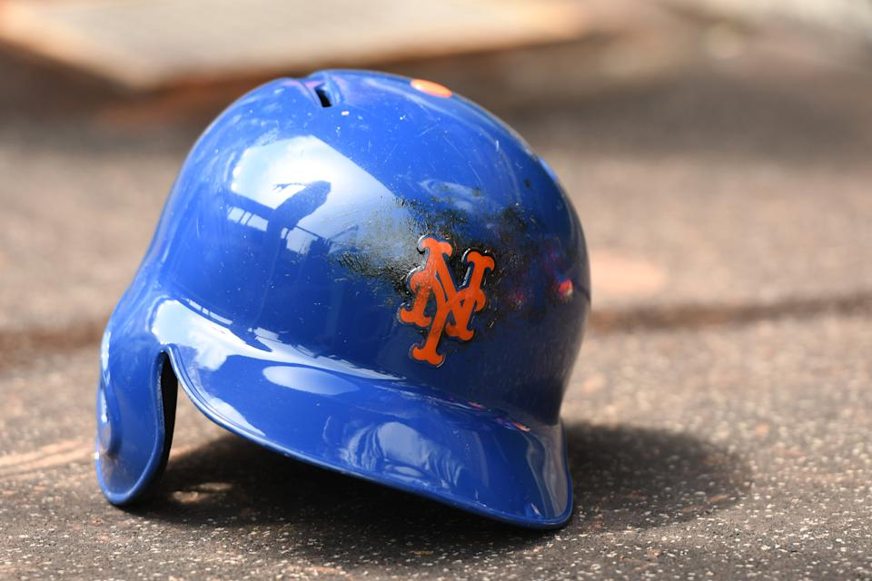 WASHINGTON, DC - JULY 04:  A New York Mets batting helmet in the dug out before a baseball game against the Washington Nationals at Nationals Park on July 4, 2017 in Washington, DC.  The Nationals won 11-4.  (Photo by Mitchell Layton/Getty Images) *** Local Caption ***
