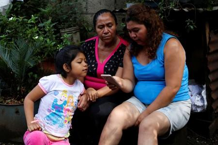 Blanca who was part of the migrant caravan in 2018 along with her grandson Anderson and was later deported from the U.S., is seen with her daughter Yesenia and granddaughter Alexandra in Escuintla