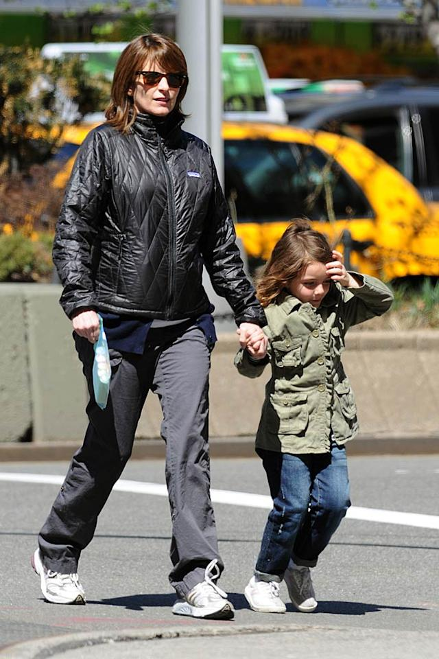 """Fellow Manhattanite Tina Fey -- who is five months pregnant with her second child -- took her daughter Alice out for a stroll on Sunday. At a recent book signing for her memoir <i>Bossypants</i>, Fey revealed that her 5-year-old daughter is the inspiration behind most of the character Tracy Jordan's one-liners on """"30 Rock."""" Elder Ordonez/<a href=""""http://www.infdaily.com"""" target=""""new"""">INFDaily.com</a> - April 10, 2011"""
