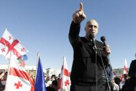 Nika Melia, head of the United National Movement, gestures while speaking to Georgian opposition supporters of former president Mikheil Saakashvili during a rally in his support in front of the prison where former president is being held, in Rustavi, about 20 km from the capital Tbilisi, Georgia, Monday, Oct. 4, 2021. Saakashvili was detained in Tbilisi on Saturday, Oct. 1, 2021. Georgia earlier declared Saakashvili wanted as a person convicted in absentia in several criminal cases and treated as a suspect in some others. Georgian authorities have warned repeatedly that he would be detained immediately once over the border. (AP Photo/Shakh Aivazov)