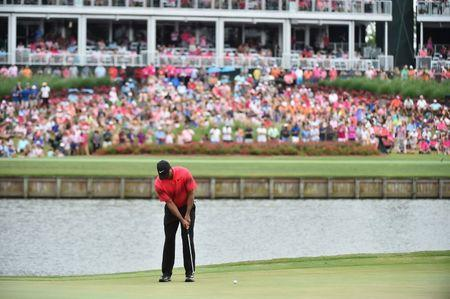 May 13, 2018; Ponte Vedra Beach, FL, USA; Tiger Woods putts on the 16th green during the final round of The Players Championship golf tournament at TPC Sawgrass - Stadium Course. Mandatory Credit: Jasen Vinlove-USA TODAY Sports