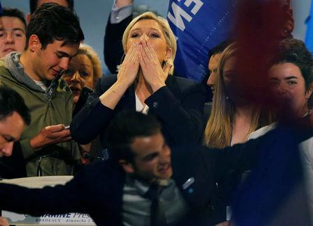 Marine Le Pen, French National Front (FN) political party leader and candidate for French 2017 presidential election, greets supporters at the end of a political rally in Bordeaux, France, April 2, 2017.  REUTERS/Regis Duvignau