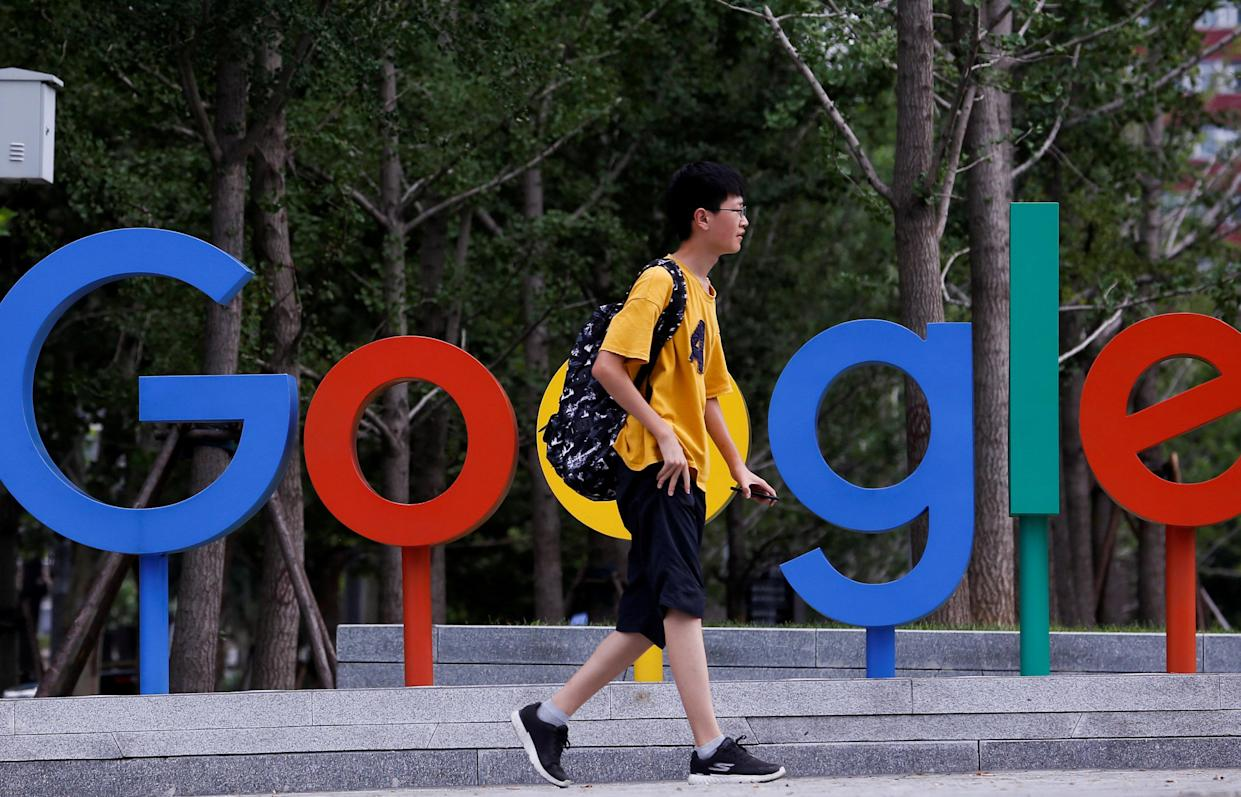 A man walks past the brand logo of Alphabet Inc's Google outside its office in Beijing, China, August 8, 2018. REUTERS/Thomas Peter