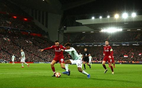 Kingsley Coman of Bayern Munich competes with Trent Alexander-Arnold of Liverpool during the UEFA Champions League Round of 16 First Leg match between Liverpool and FC Bayern Muenchen - Credit: GETTY IMAGES