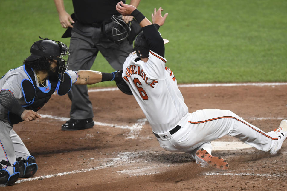 Baltimore Orioles' Ryan Mountcastle (6) is tagged out at home by Miami Marlins catcher Jorge Alfaro while attempting to score on a double by DJ Stewart during the fifth inning of a baseball game Wednesday, July 28, 2021, in Baltimore. (AP Photo/Terrance Williams)
