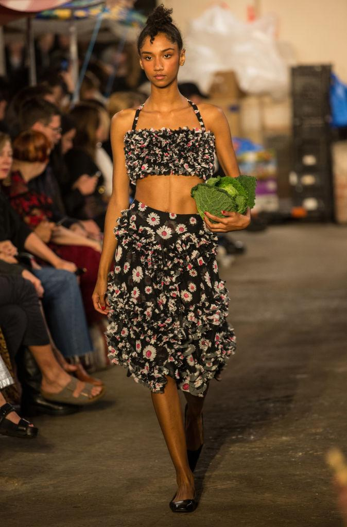 <p>A model walks the runway carrying a large cabbage at the Molly Goddard show during London Fashion Week 2018. (Photo: Rahman Hassani/SOPA Images/LightRocket via Getty Images) </p>